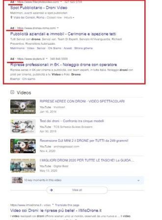 Seo e sem, foto di una pagina dei risultati Google con annunci organici e con annunci a pagamento.