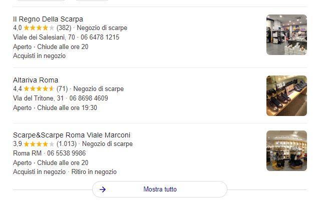Tre schede Google My Businessa aventi valutazioni diverse, pubblicate una sopra l'altra dal motore di ricerca.